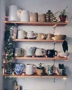 Mug shelfie- festive addition. #festivefaffing is in overdrive and I am slowly adding sparkle to every corner of our home (vintage Christmas tree pot holder bundles of bay leaves and some teeny tiny fairy lights. Thanks @geo_fleur for the surprise plant in the post! Some new mug/jug candy too: I was thrilled to find the work of amazing potter @lucyrutter who lives 2 minutes walk away!)
