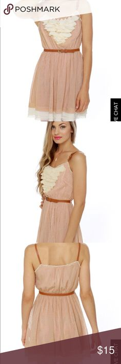 """Dust blush dress you take a shine to all things glittery, then the Gold Dust Woman Blush Dress is sure to spurn your gold fever! Light pink chiffon is adorned with shimmery gold specks and has ruffly cream accents at neck and hemline. Brown, vegan leather skinny belt tops an elastic waistband and matches the adjustable brown shoulder straps. Fully lined. Model is wearing a size small. Small measures 30"""" long plus adjustable straps. 22"""" waist (relaxed). 36"""" bust. 100% Polyester. Dry Clean…"""