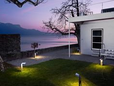 Plantons by Romain Viricel - outdoor lighting objects that can be moved around without damaging the lawn - 'ECAL: Chez Le Corbusier' exhibition at Villa 'Le Lac', Switzerland