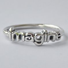 Hey, I found this really awesome Etsy listing at http://www.etsy.com/listing/130083959/imagine-sterling-silver-stack-ring-with