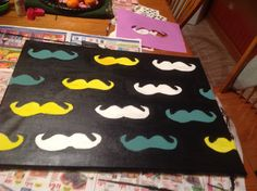 DIY painted mustache canvas! Made by: Beth Vaught, Danijela Micic, and Brooke Otis.