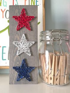 This super adorable mini stacked trio of stars is the perfect patriotic punch to your summer decor. This listing is for a string art mini star trio sign measuring approximately 3.5 x 9.5. Board is stained with our gray stain as pictured above and has red, white, and blue string. #artsandcrafts