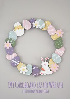 Make an adorable DIY Cardboard Easter Wreath for free out of materials you already have! via littleredwindow.com