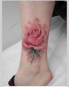 Pale pink rose tattoo. L)