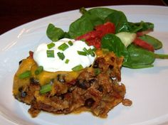 Another recipe from the Campbells Slow Cooker cookbook.  This simple casserole consists of ground beef, tomato soup, diced tomatoes with green chiles, corn tortillas and cheddar cheese.