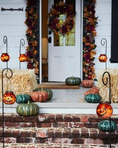 Guide eager trick-or-treaters to your doorstep with friendly pumpkin faces. Our jack-o-lanterns feature built-in LED lights that shine through crackled mercury glass to produce a haunting amber glow. Fall Lanterns, Lanterns Decor, Pumpkin Decorating, Porch Decorating, Decorating Ideas, Fall Home Decor, Autumn Home, Realistic Christmas Trees, Outdoor Topiary