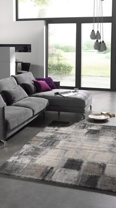 Grey area rug in square pattern