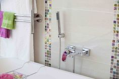 Colourful towels and accessories match brightly coloured and shimmering strips beautifully Color Pop, Colour, House Colors, Bathroom Hooks, Bright Colors, Towels, Mosaic, Accessories, Color