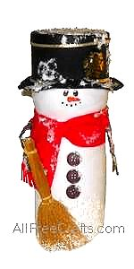Recycle a container for Carnation coffee-mate to make this snowman.  Hat is made from a salt box or a circle of cardboard.