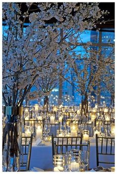 Stunning White Blossom and Candle wedding Reception