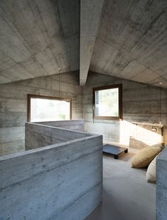 Concrete holiday home in northern Italy by 35a Studio features pointed roof