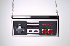 Ohhh I must!....Classic NES Controller  Laser Cut Stacked Acrylic by LicketyCut, $25.00