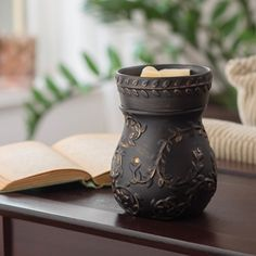 """NEW Peppercorn Illumination 19.99 Allow 3-4 Business Days to Ship  This warmer, in an elegant all over black with rich, burnished gold vine accents, uses a soft halogen bulb to create a warm glow and release the scent of your favorite fragrance. Has a removable dish and includes the warming bulb.  Warmer Details:  ⦁ Length: 4.5"""" ⦁ Width: 4.5"""" ⦁ Height: 6.5"""" ⦁ Electrical Rating: 120V, 60Hz, 25W ⦁ Bulb Type: NP5 Candle Warmers Etc replacemen bulb ⦁ Switch Type: Dial Switch  Ships from MO"""