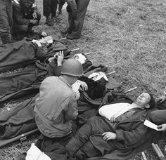 In this photo: US Army medical personnel treat injured French civilians, wounded during the invasion. June Civilians are all properly tagged. (US National Archives) Army Medic, Operation Market Garden, Man Of War, D Day, Vietnam War, Military History, Us Army, Dieselpunk, World War Ii