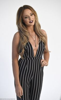 Overexposed: The Geordie Shore star shows off a lot of cleavage in a daring striped jumpsu...