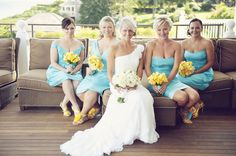 blue and yellow wedding colors except with sunflower bouquets instead