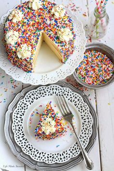 My favorite Vanilla Birthday Cake with Vanilla Bean Frosting - The lightest, fluffiest and perfectly delicious frosted vanilla cake with sprinkles – a hit for a special birthday or any celebration!