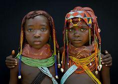 Two little Mumuhuilas girls, Angola. Photo by Eric Lafforgue.