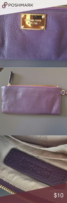 Michael Kors wristlet Purple Michael Kors wristlet. Scratches on the front gold Michael Kors emblem. Never used but it was in a bag with other purses. The wristlet itself is in good condition. Michael Kors Bags Clutches & Wristlets
