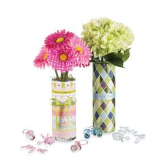 Scrapbook paper inside a glass vase with a cute bow on the ouside silk flowers on the inside...adorable for a shower or outdoor event!