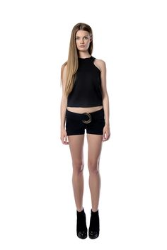 Black detailed shorts with metallic element  This black shorts is cut to sit low on the waist to create the appearance of longer, leaner legs. It is decorated with a polished gold accessory. It is perfectly combined with an athletic - inspired black scuba separate. We recommend styling it with sandals.