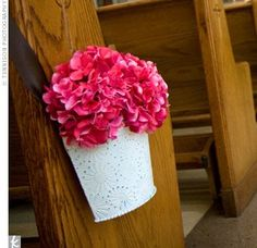 At the historic church, white tin baskets filled with bright pink hydrangeas added color to the aisle.