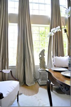 I like to puddle drapes for a more luxurious look!  TG