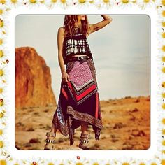 FREE PEOPLE BEDOUIN TRAVELLER SKIRT $128 MEDIUM Bold style requires contrast prints, an asymmetrical hem and a free spirit -- all wrapped into Free People's ankle-grazing maxi skirt. Shell: Rayon; Lining: cotton Hand wash Imported Wide elastic waistband Allover blocked-print Maxi silhouette Handkerchief hem Lined Longest point hits at ankle; approx. 30 inches long Free People Skirts Maxi