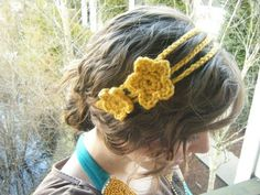 I'll have to try something like this with my own crocheted flowers instead of gluing them to barrettes.
