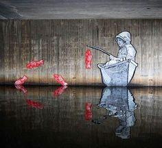 Street Art by Joe Iurato in the Viskan River Sweden.