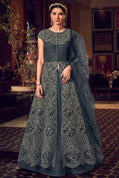This astonishing anarkali is delicately embroidered with with dori, sequins and stone work. This Round neck and Short Sleeve ensemble comes as an unstitch dress material accompanied with matching net dupatta and banglori silk fabric that can be customised as cigarette pant or skirt. Dupatta adorned with Stone Work. #dark grey #anarkali #indian #Andaazfashion #USA