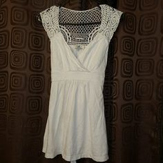 Lei top Pretty white embroidered details flattering and tie to taper waist. lei Tops Blouses