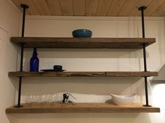 Open Pipe Shelves Made from old barn boards and hung with iron pipe