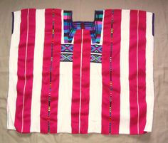 Maya huipil from Oxchuc | by Teyacapan. Huipil purchased in January 2006 in the Tzeltal Maya community of Oxchuc, Chiapas. Over time the red stripes on the Oxchuc huipils have gotten wider and wider.