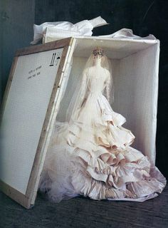 """When shipped abroad, a Christian Lacroix wedding dress travels upright in a cloth case, each layer resting in a bed of tissue. Such extraordinary care and attention to detail is the foundation of the couture."""