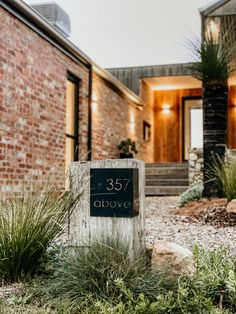 Cozy Coffee Shop, Passive Solar Homes, Australian Native Garden, Solar House, Garden Studio, Australian Homes, Facade House, Exposed Brick, House And Home Magazine