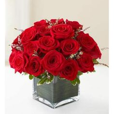 The classic Valentine gets a modern makeover in this irresistible arrangement. Gorgeous red roses arrive beautifully arranged in a chic glass cube vase wrapped with an exotic leaf ribbon. Ideal Valentine Gift Send this #Flowers to #Bahrain