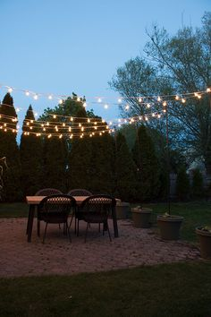 how-to-create-a-canopy-of-string-lights-over-your-patio-or-deck Learn how to easily create a DIY arbor over your patio or deck area using string lights for a stunning evening glow! Outdoor Spaces, Outdoor Living, Outdoor Decor, Christmas Light Clips, Diy Arbour, Patio Umbrella Lights, Patio Lighting, Landscape Lighting, Lighting Design