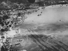 B-25 Mitchells of the 5th US Army Air Force attack Japanese shipping in the harbor at Rabaul.
