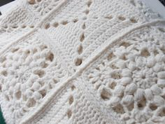 I like the combination of squares on this afghan. Cream White Granny Square Blanket : Vintage Afghan Crochet. $86.00, via Etsy.
