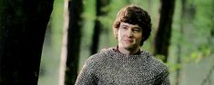 Morded laughing at Merlin's jokes. Oh, grown-up Mordred, I should hate you for what you did to Arthur but I can't, which is entirely unfair. [GIF]