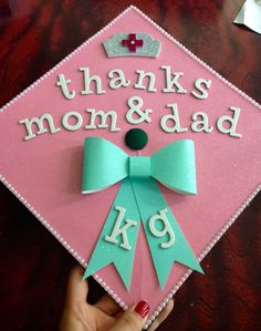 """Thanks mom & dad"" nursing grad cap! All my favorites: pearls, bows, glitter, pink & tiffany blue, & of course nursing!"