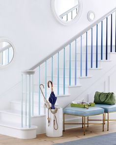 Blue Step by Step - Using little test pots of paint, we coated the uprights in twos, pairing them off on adjacent steps and graduating the tone from light to dark to create an ombre effect all the way up the banister. So easy to do, such a striking effect.