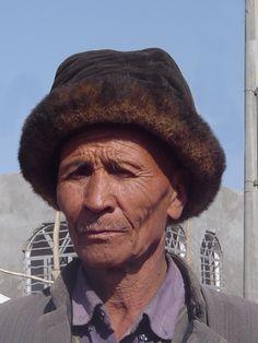 Hotan-Market Man in Fur Hat