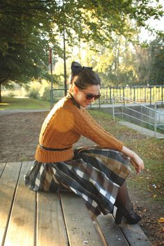 The French toast sweater and the oversize check skirt coordinate perfectly
