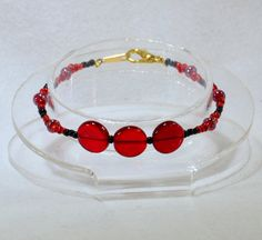 Blazing Combo: TaJaDor! A Kamen Rider OOO inspired beaded bracelet with bright reds by FransColorCreations