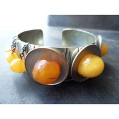 genuine amber bracelet,costume amber bracelet,natural amber... (€62) ❤ liked on Polyvore featuring jewelry, bracelets, letter jewelry, vintage bangle, initial bangle, vintage cabochon jewelry and vintage jewellery