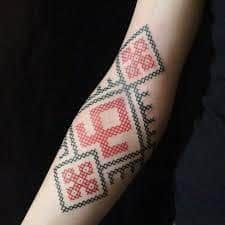 What does cross stitch tattoo mean? We have cross stitch tattoo ideas, designs, symbolism and we explain the meaning behind the tattoo. Red Tattoos, Body Art Tattoos, Sleeve Tattoos, Forearm Tattoos, Girl Tattoos, Best Tattoo Designs, Tattoo Designs For Women, Schwarz Rot Tattoo, Black Red Tattoo