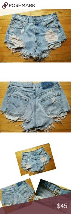 """Furst of A Kind Distressed Levis Denim Shorts Hot Preowned Furst of A Kind Distressed Upcycled Levis Denim Shorts Cutoffs Raw Edge  No size tag but they run small, see measurements provided  Light wash denim Five button fly Distressed through out  Front rise is approx 10 1/2"""" Waist across the front from seam to seam is approx 14 1/2"""" Very good distressed condition Levi's Shorts Jean Shorts"""