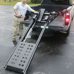 The Rampage power lift motorcycle ramp is a great alternative to the normal motorcycle loading ramp method! Motorcycle Loading Ramp, Motorcycle Trailer, Motorcycle Wheels, Porte Moto Camping Car, Ramps For Trucks, Astuces Camping-car, Motorcycle Carrier, Truck Accesories, Minivan Camper Conversion